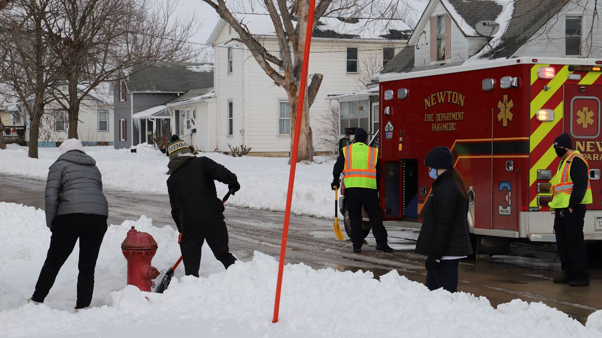 Newton Fire Department Staff and Newton High School National Honor Society Students Work to Clear F